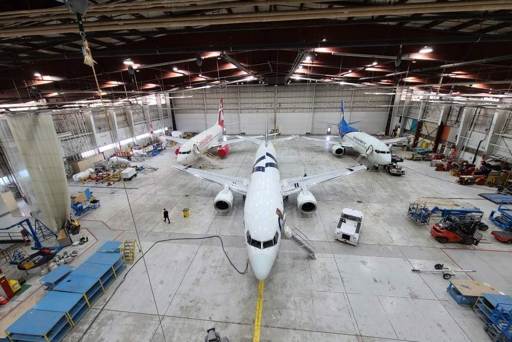 Airline Hanger with planes in it